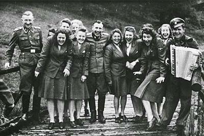 Auschwitz guards celebrating the killing of Jews