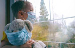 Child with Masked Teddy Bear